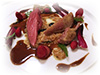 Pigeon cooked at low-temperature, wild strawberries, farro