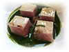 Braised yellowtail, parsley, roasted onion
